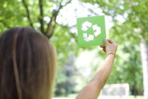 iStock 42872628 LARGE 300x200 - Woman holding a recycle sign